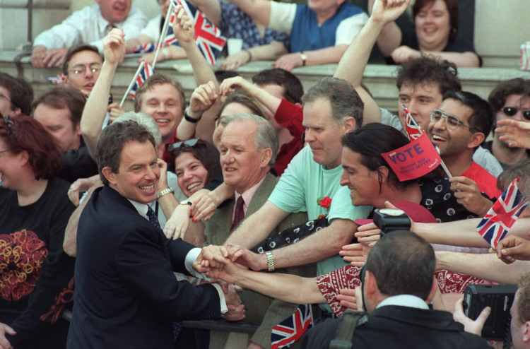 Prime minister Tony Blair is greeted by supporters outside Downing Street on his arrival, ushering in the New Labour era,2 May 1997. Gerry Penny/AFP via Getty Images