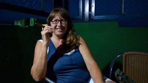When in Cuba... Vanessa enjoys one of the famous local cigars.