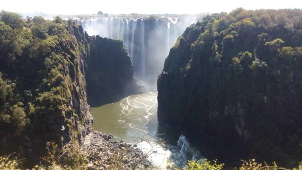Victoria Falls seen from the bridge over the Zambezi River, on the border between Zambia and Zimbabwe.