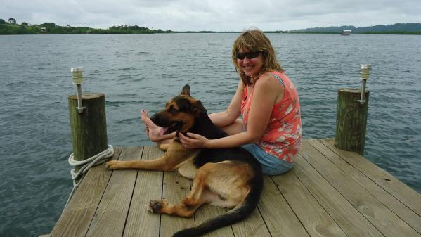 Bobby-three-legs joins Vanessa on the dock in Bocas del Toro, Panama