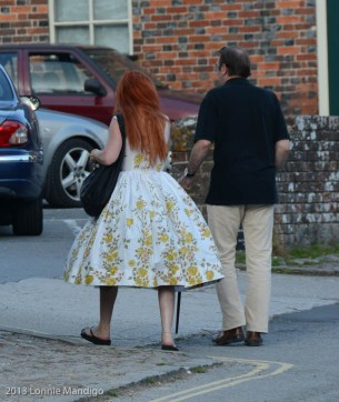 While waiting to cross the road, I noticed this woman with beautiful red hair and a hoop skirt (at list I think it's a hoop skirt). I've never seen one in real life before. It looked great!