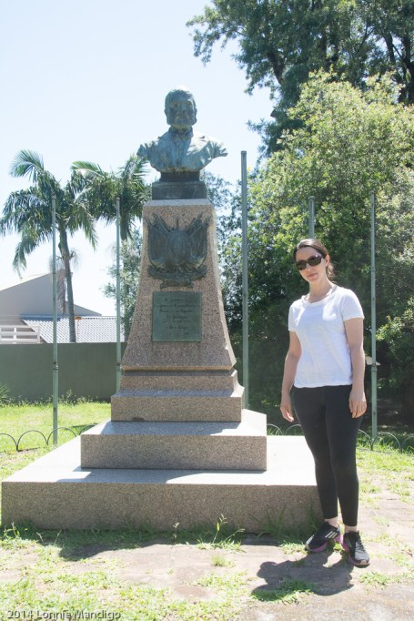 Fabio's wife Elisangela beside a statue of her great great grandfather.