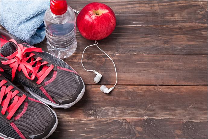 Sportequipment mit Apfel