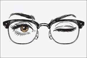 Braune Augen mit Browline-Brille
