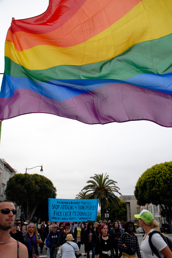 rainbow flag trans marchers