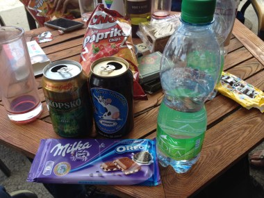 A truly American style snack-fest: one Macedonian lager, one stout brought from back home, some mineral water, paprika-flavored potato chips, and Milka chocolate with Oreo (the king of all Milka bars).