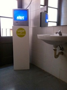 Loop festival video art in the men's toilet at Centre Civic Pati Llimona in Barcelona.