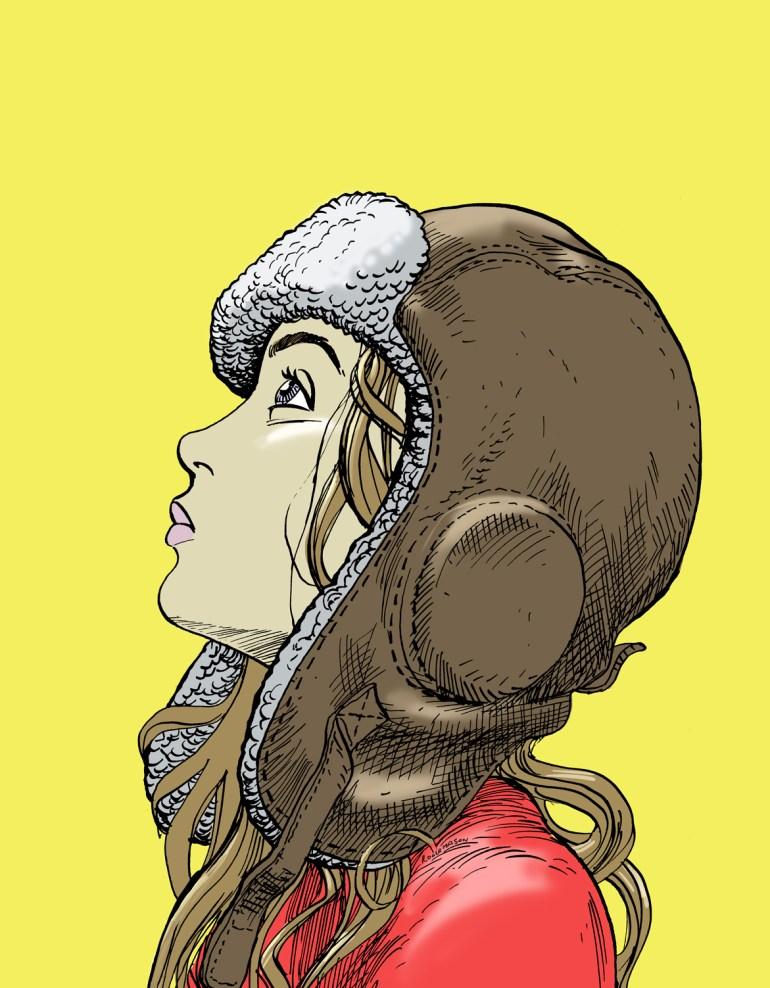 A young girl wearing an aviators hat