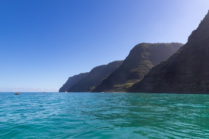 You can visit the Na Pali Coast State Park by either a helicopter ride or by taking a boat to the coast in Hawaii.