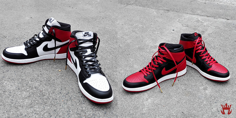 two pairs of jordans with gold tip shoelaces