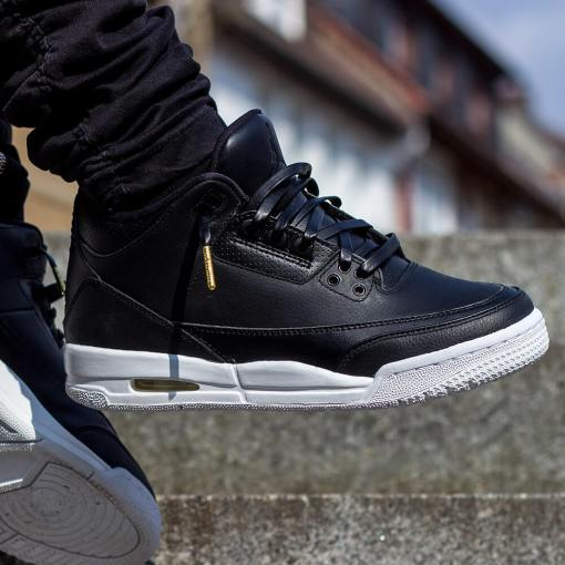 black jordans with black leather shoelaces with gold tips 2