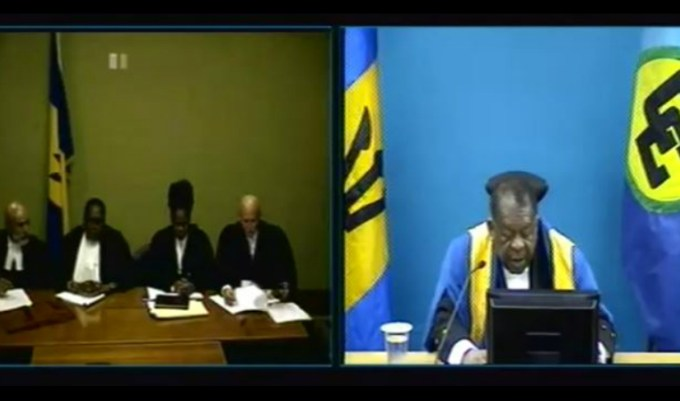 CCJ President Sir Dennis Byron (right) delivering the judgment today by teleconference to the attorneys for the applicant and respondent.