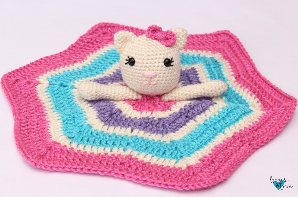 Finished kitty lovey with the star blanket laid flat.