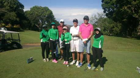 Ayers Keroh caddies with ...
