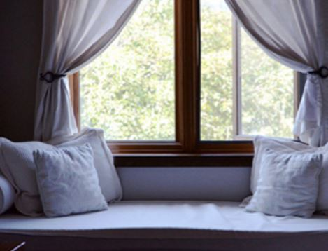 A quaint daybed or reading nook for a relaxing stay at the Howe Sound Inn.
