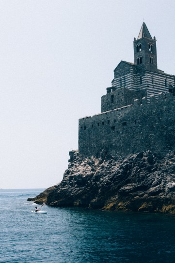 Kayaking around a church that looks like it was made for a movie.