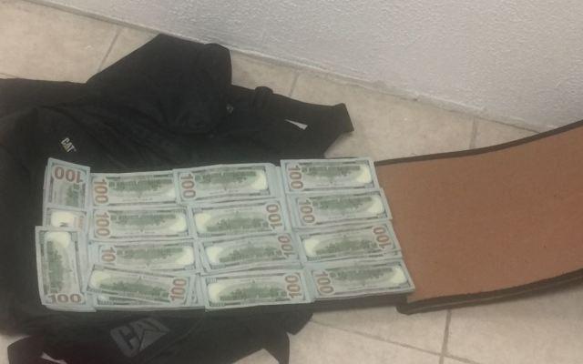 Detienen a pareja de colombianos con 225 mil dólares en el AICM