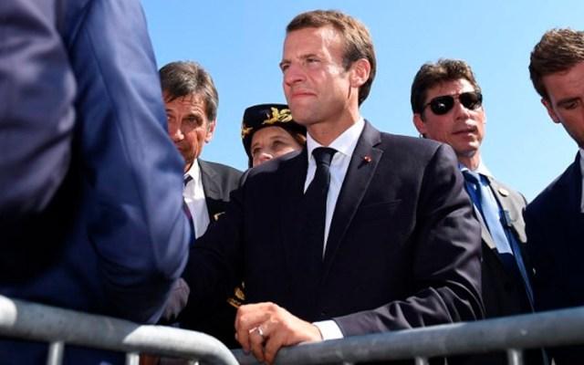 Investigan a jefe de seguridad de Macron por golpear a manifestante - Foto de AFP