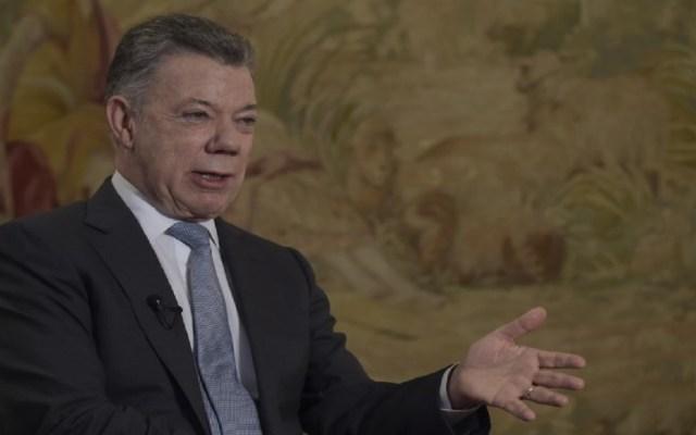 Juan Manuel Santos responde acusaciones de Maduro - Foto de AFP / Raúl Arboleda