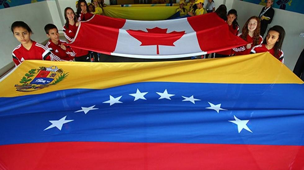 Canadá dará 53 millones de dólares a Venezuela - Banderas de Canadá y Venezuela. Foto de Getty Images
