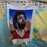 Mohamed Salah, la estrella de Egipto - EPA3554. EL CAIRO (EGIPTO), 14/06/2019.- Vista de una bandera con la imagen del delantero egipcio Mohamed Salah, este viernes, en un taller de banderines de El Cairo, Egipto. La ciudad será la anfitriona este año de la Copa Africana de Naciones, en la que participarán 24 equipos del 21 de junio al 19 de julio. EFE/ Mohamed Hossam