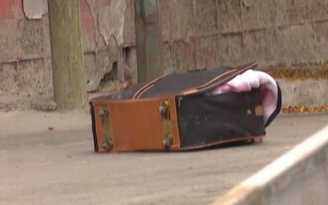 Detienen a hombre que transportaba cuerpo desmembrado en maletas - maleta