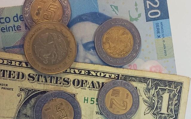 Dólar supera la barrera de los 20 pesos en ventanillas - Peso doólar dólares tipo de cambio moneda billetes dinero
