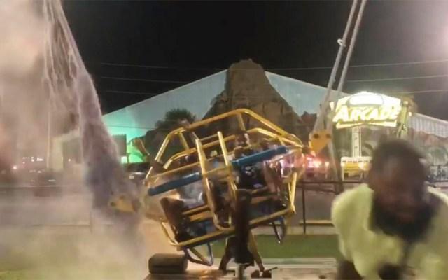 #Video Cable de juego mecánico se rompe antes de lanzar a hombres por los aires - hombre cable parque de atracciones florida