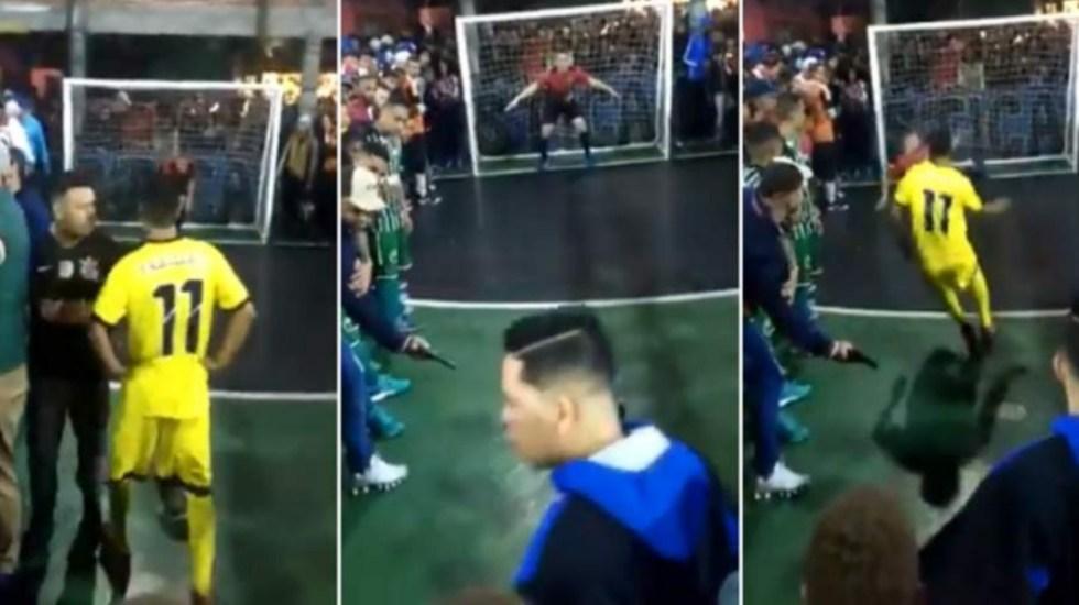 #Video Amenazan con pistola a jugador antes de cobrar penal - penal brasil