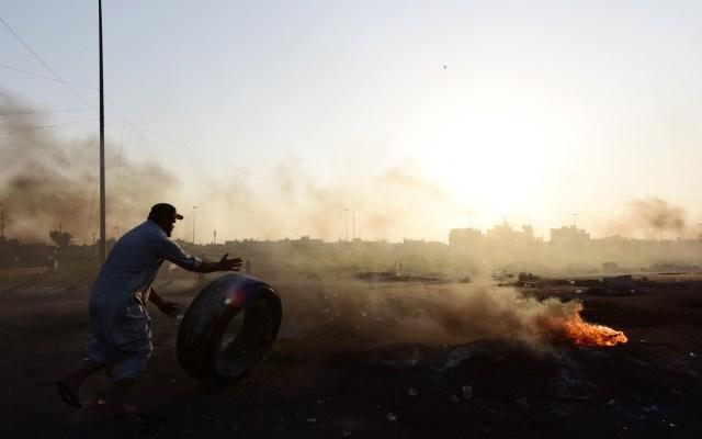 Irak regresa a la calma, tras jornadas de protestas que dejaron 99 muertos - Destrozos durante protestas en Irak. Foto de EFE