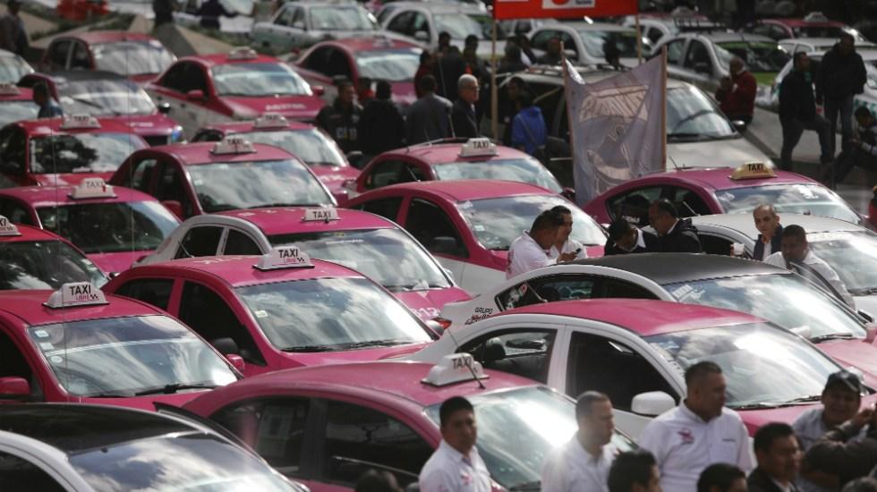Amagan taxistas con nueva movilización el 21 de octubre - Parte de la movilización de taxistas el 7 de octubre. Foto de EFE