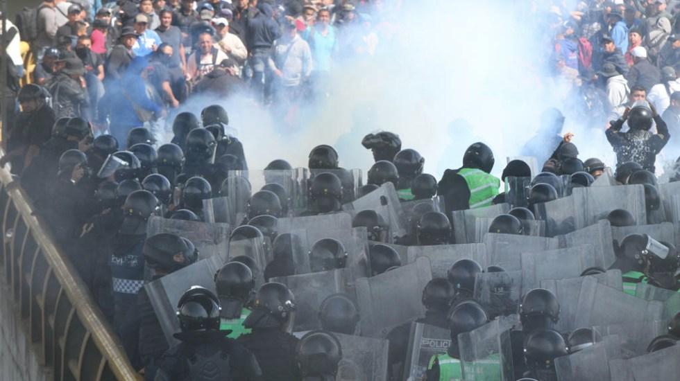 Desaparición de granaderos no desató más violencia, sostiene Sheinbaum - Policías federales protesta Ciudad de México Aeropuerto