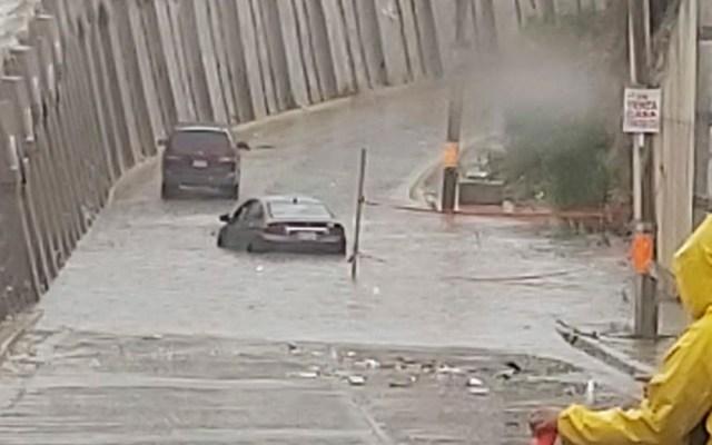 Lluvias en Tijuana inundan vialidades principales - Inundación en Tijuana. Foto de Lila Avila