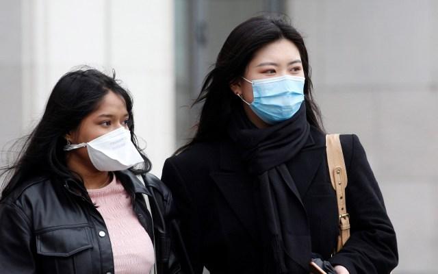 Miedo al COVID-19 frenó varias marchas del Día de la Mujer en el mundo - Mujeres con cubrebocas ante el temor de coronavirus