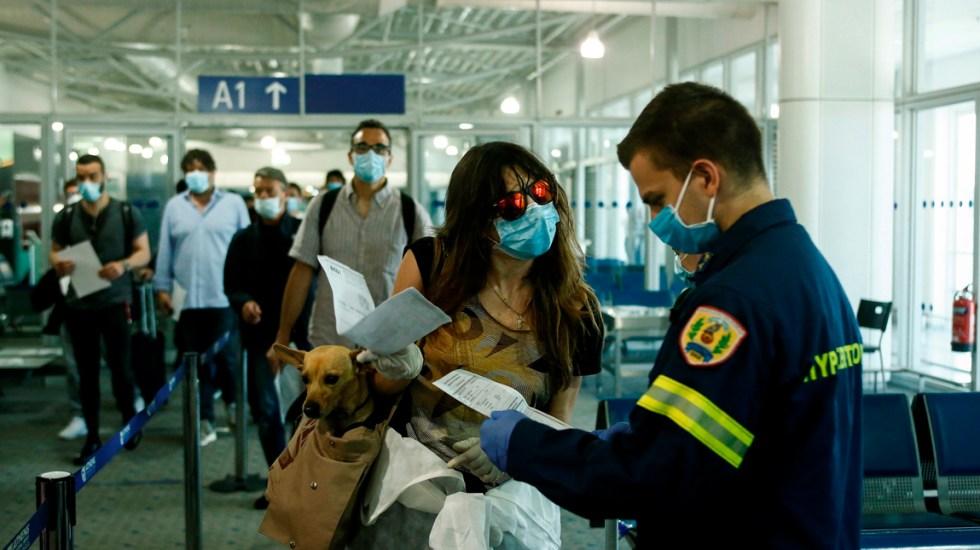 Grecia reabre sus puertas a turistas extranjeros tras pandemia de COVID-19 - Aeropuerto Internacional de Atenas, Grecia