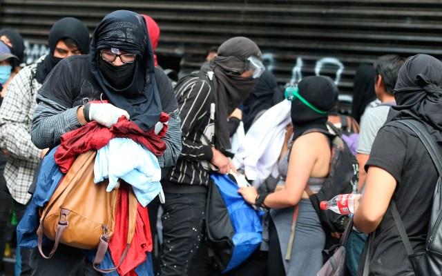 FGJ abre seis carpetas de investigación tras saqueos a negocios durante manifestación - saqueos marcha cdmx