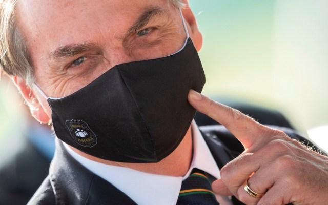 Bolsonaro veta uso obligatorio de cubrebocas en comercios, templos y escuelas de Brasil - Foto de EFE