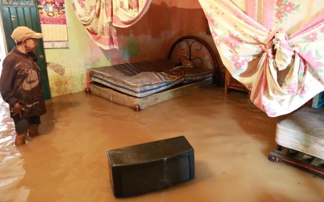 Lluvias en Jalisco y Colima por tormenta tropical Hernán serán de alto riesgo - Inundación en casa ubicada en el municipio de Benito Juárez, Guerrero, por las lluvias ocasionadas por la tormenta tropical Hernán. Foto de EFE