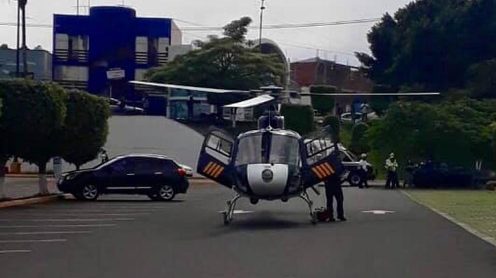 Disparan delincuentes contra helicóptero de CES Morelos; oficial resulta herido - Helicóptero de la CES Morelos. Foto de @ssp.morelos