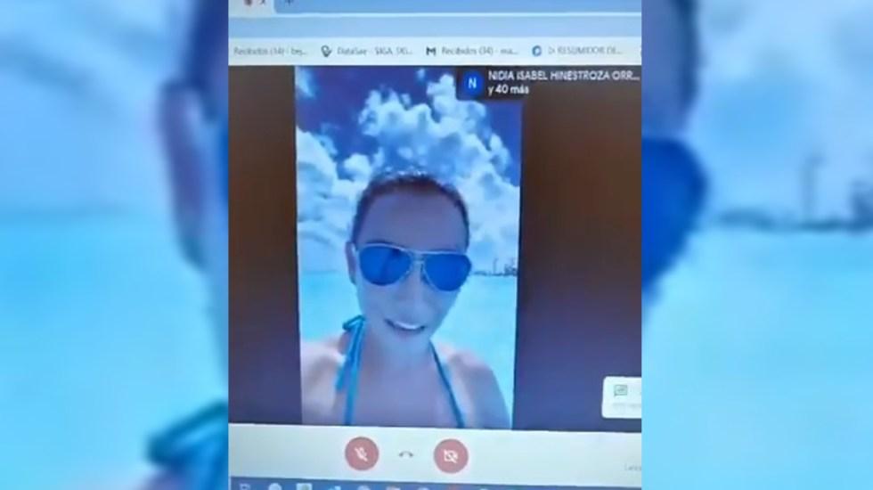 """#Video """"Profe, estamos en Cancún""""; joven toma clases virtuales desde la playa - Alumna toma clases virtuales desde Cancún. Captura de pantalla"""