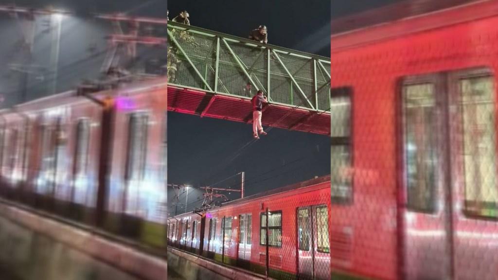 #Video Rescatan a hombre que intentó arrojarse a vías del Metro desde puente peatonal - Bomberos en labores de rescate de hombre que amenazó con arrojarse a vías del Metro. Foto de @Bomberos_CDMX