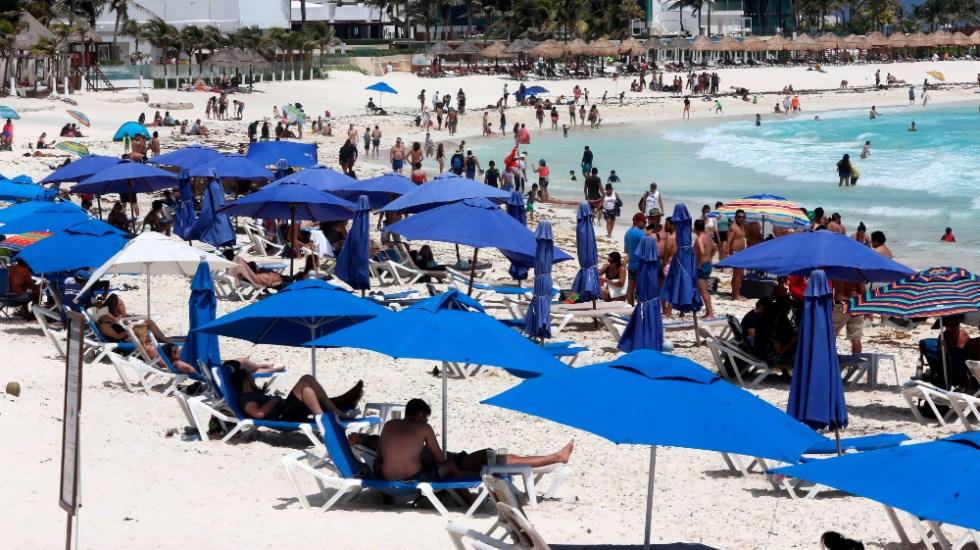 Semana Santa: AMLO pide cuidarse del COVID-19 en vacaciones - vacacionistas Semana Santa Cancun
