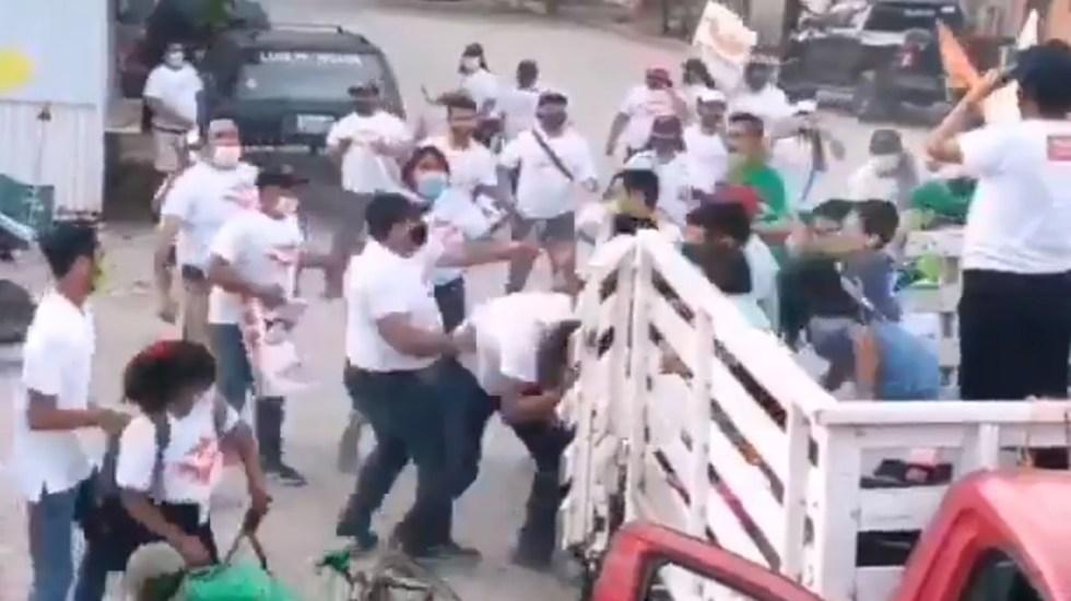 #Video Se enfrentan simpatizantes de MC y PVEM en Puerto Vallarta - Enfrentamiento entre simpatizantes del PVEM y MC en Puerto Vallarta. Captura de pantalla