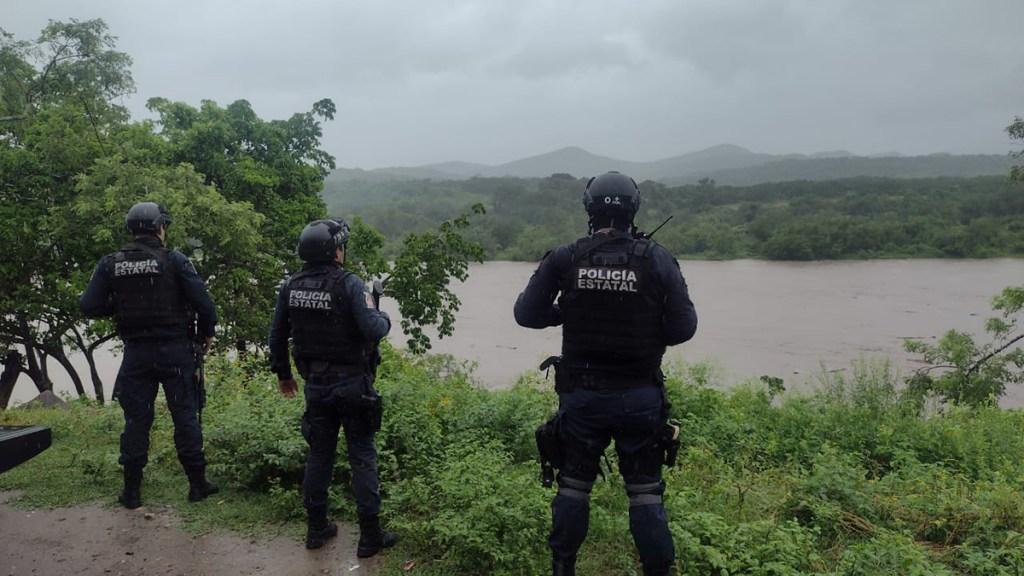 Nora se degrada a tormenta tropical tras tocar tierra en Sinaloa - Autoridades de Sinaloa vigilan la crecida de ríos por el paso de Nora