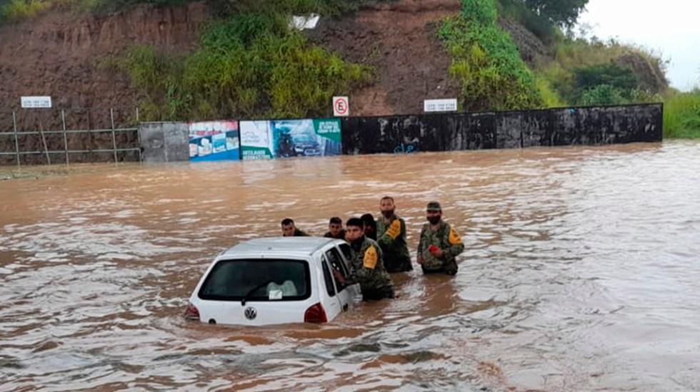 Se eleva a 11 cifra de muertos por paso de 'Grace' por México - Soldados aplican el Plan DN-III-E en Veracruz por paso de Grace
