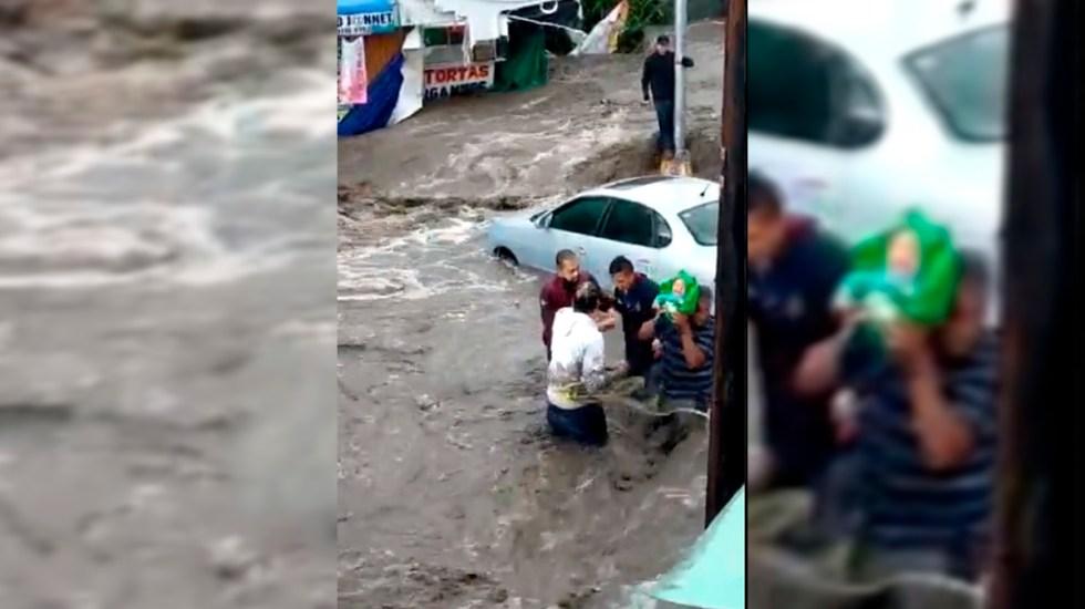 #Video Rescatan a bebé de inundaciones en Ecatepec - Rescate de bebé en Ecatepec