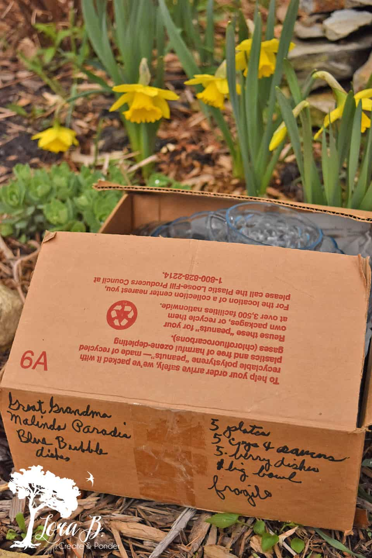 Cardboard box full of Church Sale dishes