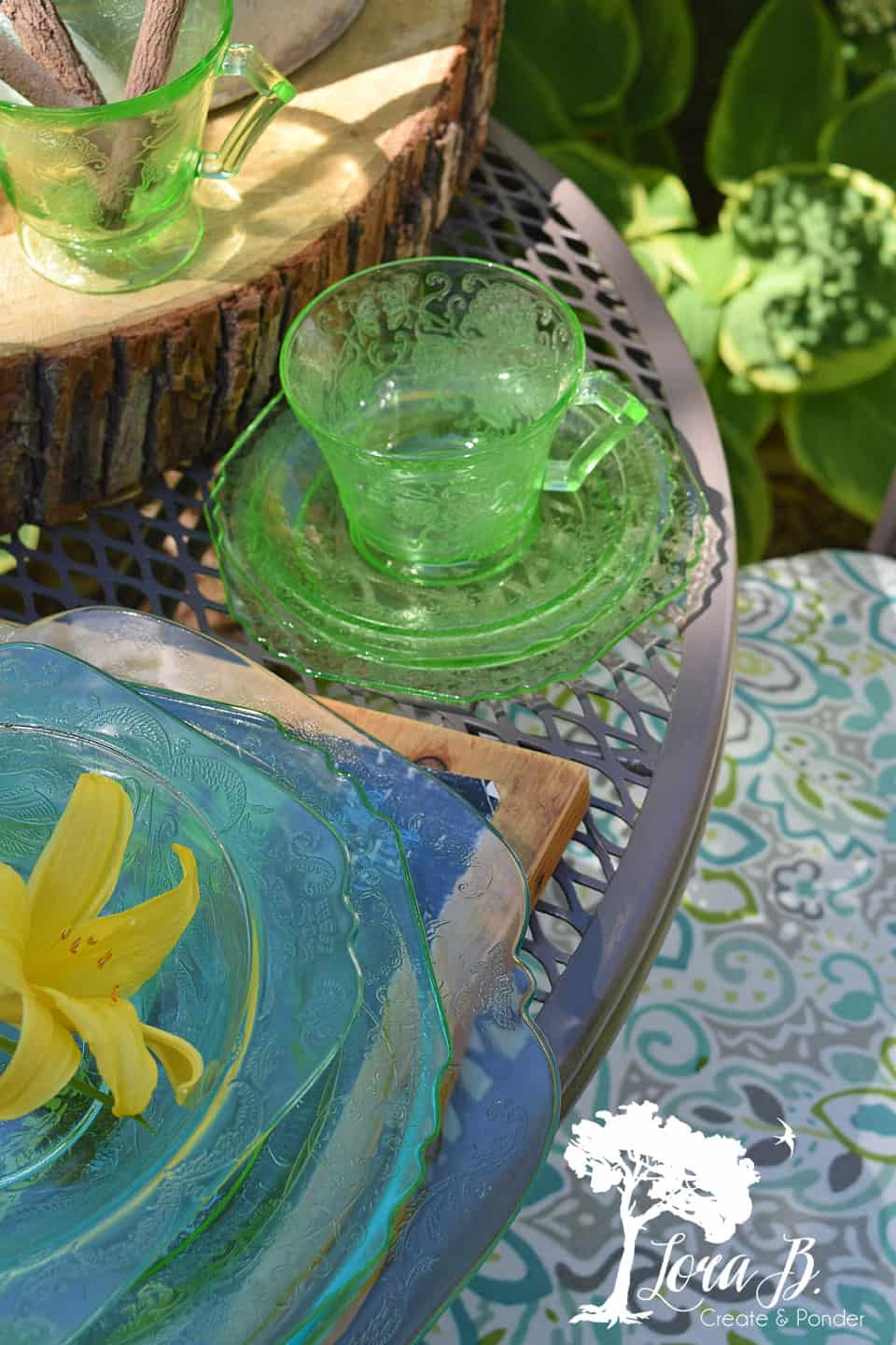 Green depression glass cup and saucer