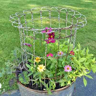 Repurposed Garbage Can Planter with Vintage Fencing