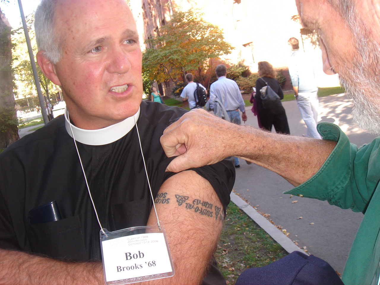 "Reverand Bob showing his new ""logos"" tattoo to Carter"